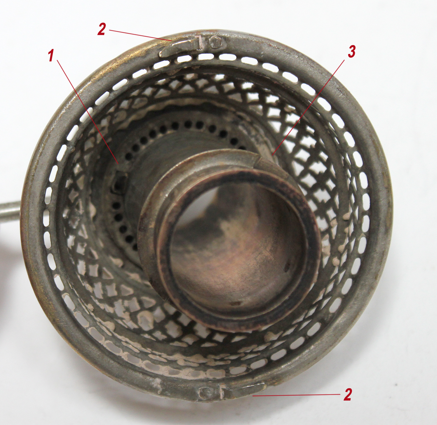 Looking down at a bare Ironclad lamp model 2 burner basket